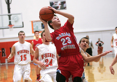 Monica Maschak - mmaschak@shawmedia.com Marian Central's Jeremy Brooks jumps for the net in a game at McHenry High School on December 6, 2012.  The Hurricanes lost 71-48.