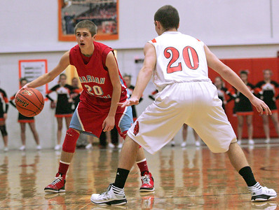 Monica Maschak - mmaschak@shawmedia.com Marian Central's Wyatt Lindell looks for an open teammate in the second half of the game at McHenry High School on December 6, 2012.  The Hurricanes lost 71-48.