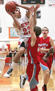 Monica Maschak - mmaschak@shawmedia.com Korey Partenheimer (22) leaps for the net in the first half of the game against Marian Central on December 6, 2012.  The McHenry Warriors won 71-48.