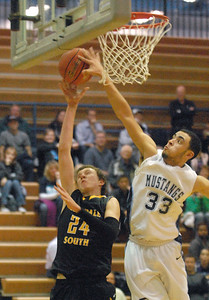 Downers Grove South's Jordan Cannon (#33) blocks HInsdale South's Larry Motuzis' shot. The Mustangs win a close varsity boys basketball game, 63-57, at home against the Hornets on Friday, Dec. 7, 2012. Staff photo by Bill Ackerman
