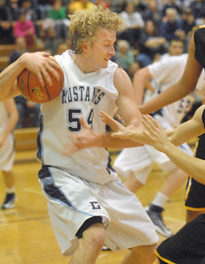 Downers Grove South's Robert Mara pulls in a rebound against Hinsdale South on Friday, Dec. 7, 2012 at home. Staff photo by Bill Ackerman