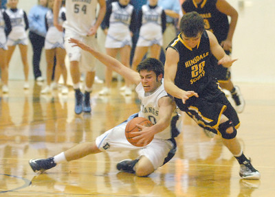 Downers Grove South's Danny Spinuzza (left) breaks D.J. Deolitsis' dribble. Downers wins a close varsity boys basketball game, 63-57, at home against Hinsdale South on Friday, Dec. 7, 2012. Staff photo by Bill Ackerman