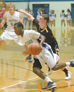 Downers Grove South's Tray Simmons drives past Hinsdale South's Jerry Stoltz. Downers South wins a close varsity boys basketball game, 63-57, at home against the Hornets on Friday, Dec. 7, 2012. Staff photo by Bill Ackerman