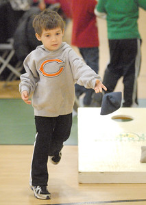 """Ryan Delaney, 4, of Lemont, tries tossing beanbags with enthusiasm. The Lemont Park District starts the new year, twelve hours early, with its """"Happy New Year Family Fun Day"""" with games, crafts, and a balloon drop at the stroke of noon on Monday, Dec. 31, 2012. Bill Ackerman — backerman@shawmedia.com"""