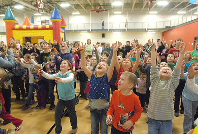"""Delighted children wait for balloons to land as the Lemont Park District starts the new year, twelve hours early, with its """"Happy New Year Family Fun Day"""" with games, crafts, and a balloon drop at the stroke of noon on Monday, Dec. 31, 2012. Bill Ackerman — backerman@shawmedia.com"""