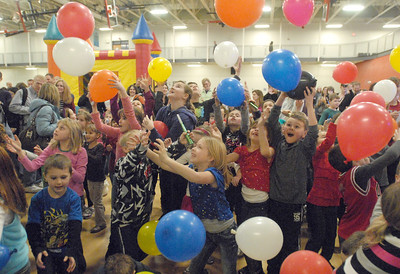 """At the stroke of noon, children capture balloons dropped from the balcony of the Lemont Park District's CORE Fitness and Aquatic Complex, starting the new year, twelve hours early, with its """"Happy New Year Family Fun Day"""" featuring games, crafts, and pizza on Monday, Dec. 31, 2012. Bill Ackerman — backerman@shawmedia.com"""