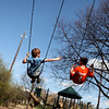 Rory Conroy, 7, and Nate Pedersen, 10, both of Geneva, swing at Pottawatomie Park in St. Charles.<br /> 3/20/2012(Sandy Bressner photo)