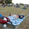 Geneva resident Brian Maloney and his three-year-old son, Liam Maloney, wait for the annual Batavia Sky Concert Independence Day fireworks display to begin at Engstrom Park in Batavia Wednesday evening.(Rena Naltsas photo for the Kane County Chronicle)