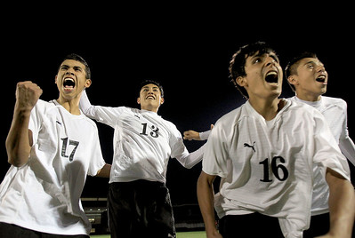 Sarah Nader - snader@shawmedia.com Harvard's Christian Carrillo (left) Abgel Sanchez, Isaih Solis and Jerry Martinez watch as the last penalty kick is made during a shootout at Wednesday's Class 2A Grayslake Central Sectional Semifinal game against Grayslake North on October 24, 2012. Harvard won, 1-0.