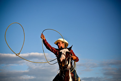 Josh Peckler - Jpeckler@shawmedia.com A roping contestant practices his roping skills before the start of the Tri-County Pro Rodeo at Milky Way Park in Harvard in July.