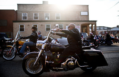 Josh Peckler - Jpeckler@shawmedia.com  Motorcycles go by during the Toys For Tots Christmas Parade in Mchenry. After the parade that included almost 800 motorcycle riders toys were collected to be donated to the U.S Marines Toys for Tots.
