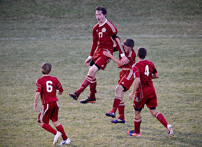 Josh Peckler - Jpeckler@shawmedia.com Marian Central's Mike Dougherty (17) jumps as he celebrates scoring a goal against Harvard during the first half of a IHSA Regional semifinal at Harvard High School.
