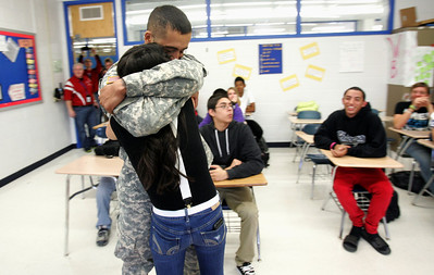 H. Rick Bamman - hbamman@shawmedia.com PFC Eric Luna of Carpentersville and 2010 Dundee-Crown graduate hugs  his sister Ivette Luna after surprising her during english class at Dundee Crown high school.