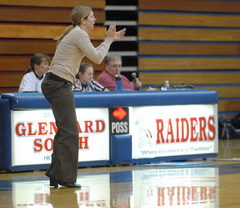 Raiders coach Julie Fonda encourages her team from the sidelines. Glenbard South girls basketball team have a 45-22 home win against Downers Grove South on Thursday, Dec. 20, 2012. Bill Ackerman — backerman@shawmedia.com