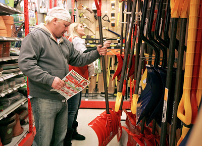Monica Maschak - mmaschak@shawmedia.com McHenry resident Christopher Zak chooses a shovel with the help of Bjorkman's ACE Hardware sales associate Kelly Lanz in preparation for a winter storm said to hit the county on Thursday, December 20, 2012.  The National Weather Service predicts four to six inches of snow during the winter storm warning effective between 3 p.m. Thursday and midnight Friday.