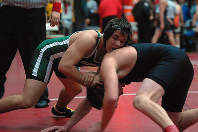 Glenbard West's Alex Morreale, left, tries to take down his opponent in a 182-lb. match during the 47th Annual Rex Whitlatch Wrestling Invitational at Hinsdale Central High School on Saturday, Dec. 14, 2012. Matthew Piechalak — mpiechalak@shawmedia.com