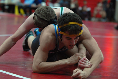 Glenbard West's Nate Orrison, top, tries to wrap up St. Charles North's Tyler Fisher during the 47th Annual Rex Whitlatch Wrestling Invitational at Hinsdale Central High School on Saturday, Dec. 14, 2012. Matthew Piechalak — mpiechalak@shawmedia.com