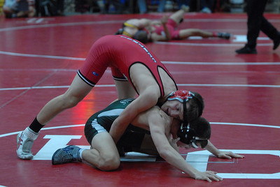 Hinsdale Central's Matt Zapka tries to tie up his opponent in a 145-lb. match during the 47th Annual Rex Whitlatch Wrestling Invitational at Hinsdale Central High School on Saturday, Dec. 14, 2012. Matthew Piechalak — mpiechalak@shawmedia.com