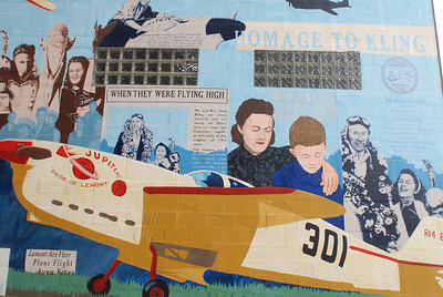 "Part of the ""Pride of Lemont"" mural on display off Front Street near the Front Street Lofts, Tuesday, Dec. 4, 2012. The mural is dedicated to the life of pilot Rudy Kling, a Lemont native who gained national fame when his won the Thompson Trophy at the Cleveland Air Races in 1937. Staff photo by Matthew Piechalak"