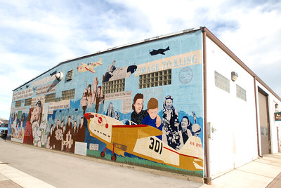 "The ""Pride of Lemont"" mural on display off Front Street near the Front Street Lofts, Tuesday, Dec. 4, 2012. The mural is dedicated to the life of pilot Rudy Kling, a Lemont native who gained national fame when his won the Thompson Trophy at the Cleveland Air Races in 1937. Staff photo by Matthew Piechalak"