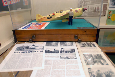 A model and archived news print related to pilot Rudy Kling at the Lemont Historical Society, 306 Lemont St. on Tuesday, Dec. 4, 2012. Kling, a Lemont native who died 75 years ago on Dec. 3, gained national fame when his won the Thompson Trophy at the Cleveland Air Races in 1937. Staff photo by Matthew Piechalak