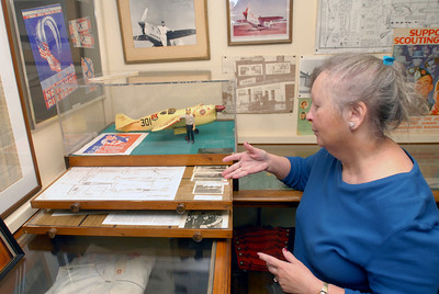 Volunteer Susan Donahue points to archived articles and photographs related to pilot Rudy Kling at the Lemont Historical Society, 306 Lemont St. on Tuesday, Dec. 4, 2012. Kling, a Lemont native who died 75 years ago on Dec. 3, gained national fame when his won the Thompson Trophy at the Cleveland Air Races in 1937. Staff photo by Matthew Piechalak