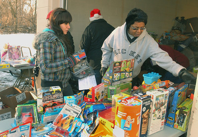 Volunteers Gabriela Colin (left) and Joan Collins, both of West Chicago, pick out age-appropriate toys for guests on Saturday, Dec. 22, 2012. Santa puts in a special appearance at the Neighborhood Food Pantries site in West Chicago, located behind the Crossroads Restoration Church. Bill Ackerman — backerman@shawmedia.com