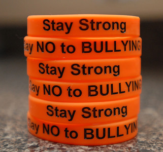 "A stack of bracelets containing the slogan ""Stay Strong"" on a counter on Wednesday, Dec. 19, 2012. Morgan Fairley, a graduate of Lisle High School, who admits to being bullied in high school, recently started the non-profit ""Just Say No to Bullying"" to inspire other children to speak out against bullying. Matthew Piechalak — mpiechalak@shawmedia.com"