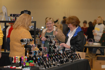 "Mary Janchenko, center, and Julie Rubel, right, both of Lemont, shop for jewelry at Lemont Park District's annual ""Shop Til You Drop"" event at The CORE Fitness & Aquatic Complex, 16028 127th St. in Lemont on Saturday, Dec. 8, 2012. Staff photo by Matthew Piechalak"