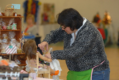 "Martha Mendoza, owner of Martha's Doll Furniture, sets up a display table at Lemont Park District's annual ""Shop Til You Drop"" event at The CORE Fitness & Aquatic Complex, 16028 127th St. in Lemont on Saturday, Dec. 8, 2012. Staff photo by Matthew Piechalak"