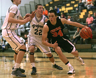 Monica Maschak - mmaschak@shawmedia.com Crystal Lake Central's Jacob VanScoyoc looks for an opening to the hoop in Wednesday night's Holiday Classic game at Jacobs High School. The Tigers beat the Trojans 63-46.