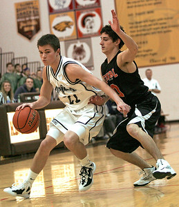 Monica Maschak - mmaschak@shawmedia.com Ian May (21) tries to push past his defender in a games against Crystal Lake Central at the Jacobs Holiday Basketball Classic Wednesday night.  Crystal Lake Central won 63-46.