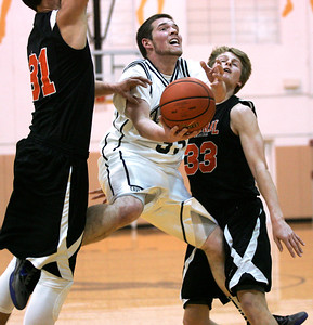 Monica Maschak - mmaschak@shawmedia.com Cary-Grove's Steve Plazak puts up a shot between two defenders in a game against Crystal Lake Central at the Jacobs Holiday Classic on Wednesday, December 26, 2012. The Tigers won 63-46.