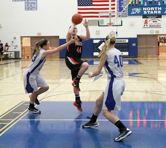 Wheaton Warrenville South's Olivia Linebarger takes a shot during their game against St. Charles North on Tuesday, Dec. 18. Sarah Minor — sminor@shawmedia.com