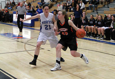 Meghan Waldron tries to keep the ball away from a St. Charles North defender in Wheaton Warrenville South's game on Tuesday, Dec. 18. Sarah Minor — sminor@shawmedia.com