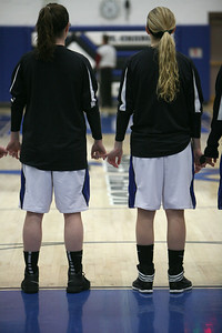 Members of St. Charles North's girls basketball team link hands during the national anthem before their game against Wheaton Warrenville South on Tuesday, Dec. 18. Sarah Minor — sminor@shawmedia.com