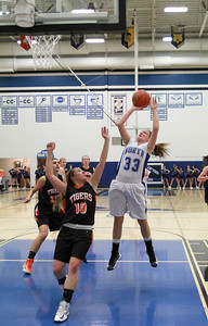 Nicole Davidson of St. Charles North goes up for a shot in their game against Wheaton Warrenville South on Tuesday, Dec. 18. Sarah Minor — sminor@shawmedia.com