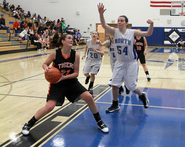 Melinda Franke drives towards the basket against a St. Charles North defender in Wheaton Warrenville South's game on Tuesday, Dec. 18. Sarah Minor — sminor@shawmedia.com