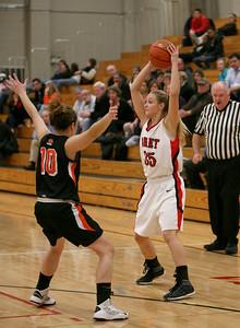 Emily Eshoo of Benet looks to make a pass during their game on Thursday, Dec. 13. Sarah Minor — sminor@shawmedia.com