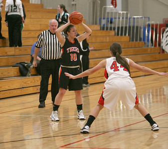 Sierra Bisso of Wheaton Warrenville South looks to pass the ball during their game on Thursday, Dec. 13. Sarah Minor — sminor@shawmedia.com
