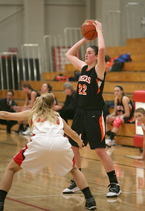 Wheaton Warrenville South's Melinda Franke tries to keep the ball from a Benet defender on Thursday, Dec. 13. Sarah Minor — sminor@shawmedia.com