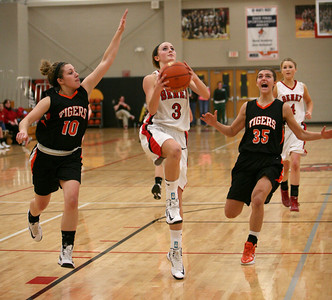 Christen Prasse goes up to shoot the ball in Benet's game against Wheaton Warrenville South. Sarah Minor — sminor@shawmedia.com