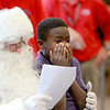 Mooseheart third-grader E.G. Barley visits with Santa at the school Friday morning. Bob Miller, principal  of Haines Middle School in St. Charles, has been portraying the jolly fellow for nine years. (Sandy Bressner photo)