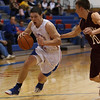 Marmion Cadets Jordan Glasgow drives to the basket against  Wheaton Warriors Gabe Partain (10) at Marmion in Aurora, IL on Friday, December 14, 2012 (Sean King for The Kane County Chronicle)