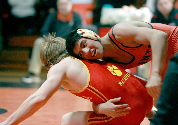 St. Charles East's Isaiah Vela (top) competes against Charlie Smorczewski of Batavia in the 138-pound weight class during their dual meet at East Thursday night. (Sandy Bressner photo)