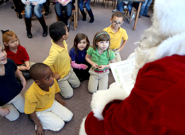 Mooseheart kindergartners visit with Santa at the school Friday morning. Bob Miller, principal  of Haines Middle School in St. Charles, has been portraying the jolly fellow for nine years. (Sandy Bressner photo)