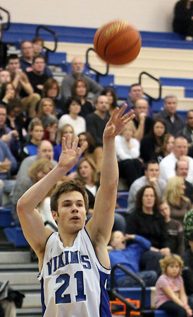 Geneva's Mike Trimble shoots a three during Friday's game against visiting Streamwood.<br /> (Jeff Krage photo for the Kane County Chronicle)