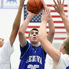 Jeff Krage – For the Kane County Chronicle<br /> Geneva's Nate Navigato takes a shot through a double team during Friday's game at St. Charles North.<br /> St. Charles 12/21/12