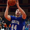 Geneva's Connor Chapman goes up for a shots during the Vikings' game at St. Charles East Friday night. (John Cox photo)