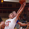 St. Charles East's James McQuillan grabs an offensive rebound during their game against Geneva Friday night.  (John Cox photo)